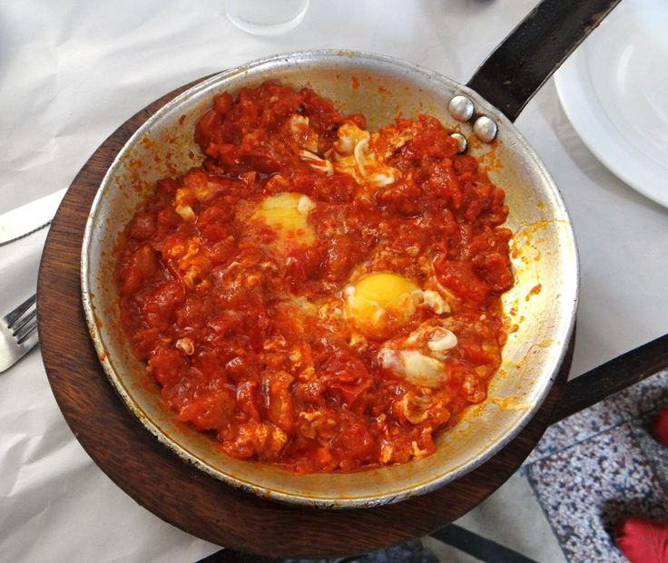 Shakshuka - our favorite israeli food. So far!...  Just try saying it tens times fast.  ...Then eat it