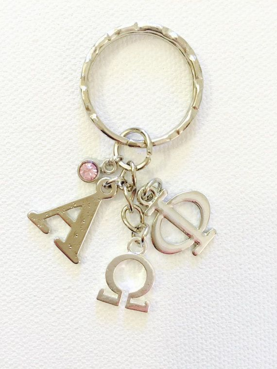 Keychain comes with 1 Alpha Charm, 1 Phi Charm, 1 Omega Charm and 1 Rhinestone All items handcrafted in a Smoke-Free environment :)  Thanks for