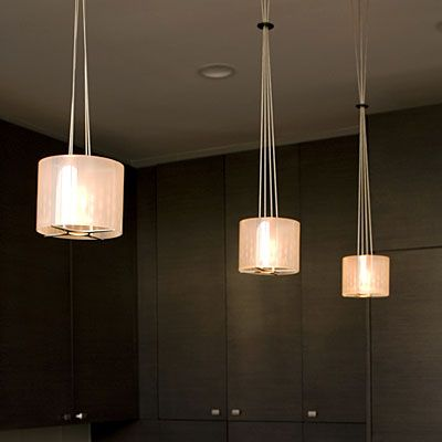 Reception Desk - Modern Pendant drop lights with recessed lights in the back for more lighting.
