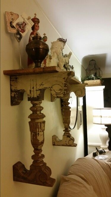 Antiques corbels and barn wood shelf with religious statues
