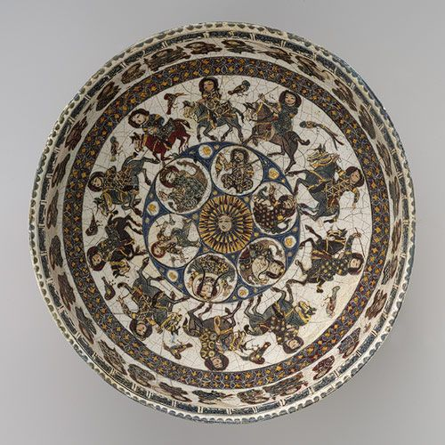 Bowl with astronomical and royal figures, Seljuq period (1040–1196), late 12th–early 13th century  Central or northern Iran  Stonepaste; polychrome in glaze and overglaze painted and gilded on opaque monochrome glaze (mina'i) دوره سلجوقيان