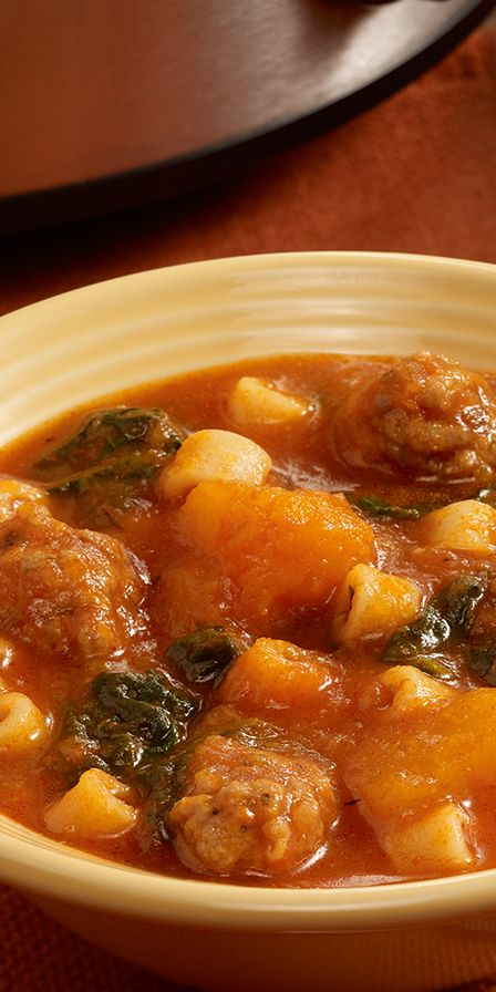 Hearty slow cooker soup recipe full of butternut squash, Italian sausage, spinach and small pasta.