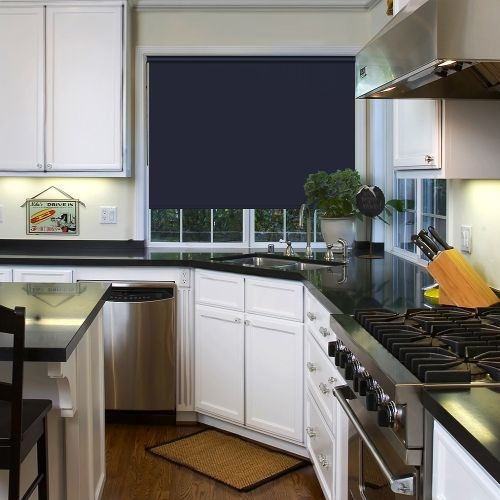 PVC flame retardant and waterproof roller blind fabric in a shade of dark blue which is made a white circular bottom bar
