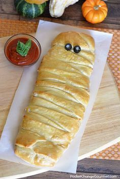 This twist on pizza makes a fun Halloween Dinner Recipe for your family, friends, to serve at a Halloween Party or take to the office. It has all your favorite pizza topping inside the dough, wrapped up to make a Mummy Calzone!