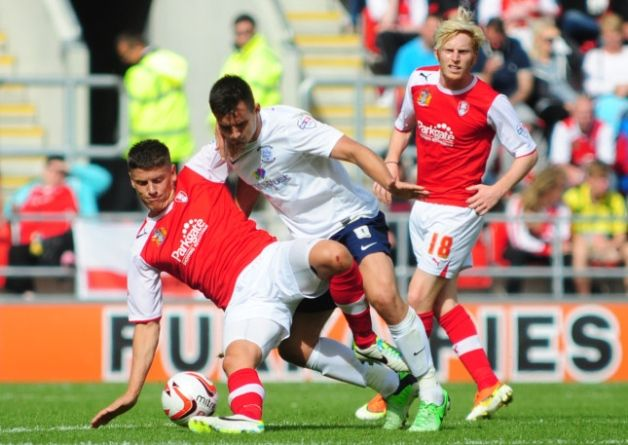PNE's Bailey Wright vies for possession with Rotherham United's Alex Revell in the first meeting between the teams this season in August