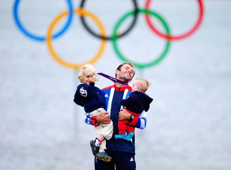 Silver medalist Nick Dempsey of Great Britain celebrates with his children