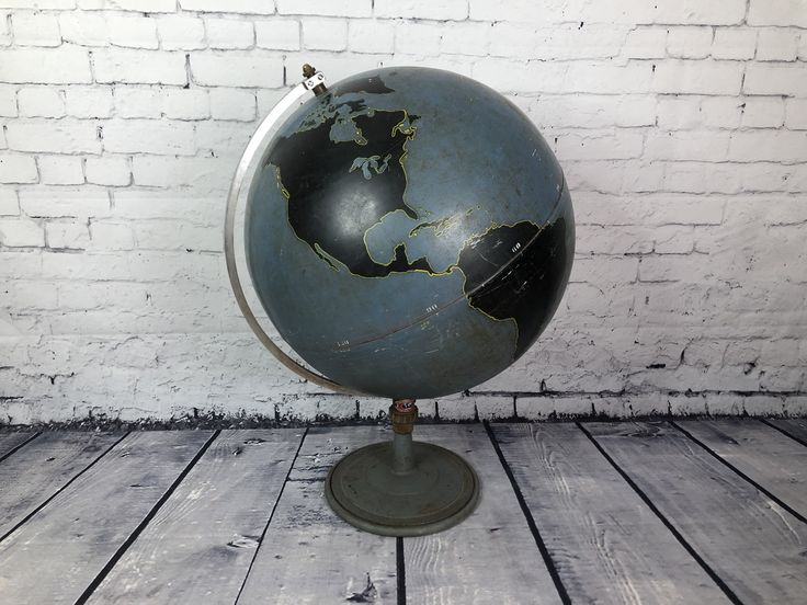 Desnoyer Geppert Globe C$1,200 // Here is a Denoyer Geppert globe. Rare. It was used to teach military aviation. The continents are black, they explained the military strategies by writing on it with chalk. Made in the United States, 1940. Very beautiful condition with vibrant colors. Note that the globe suffered 2 shocks and is slightly embossed. It does not detract from its beauty. Painted stainless steel. The screw under the globe makes it possible to move on the axes.