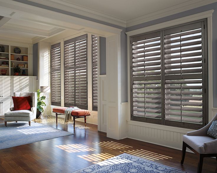 Heritance® hardwood shutters pairs the natural warmth and richness of genuine hardwood with modern sophistication and functionality. ♦ Hunter Douglas window treatments #LivingRoom
