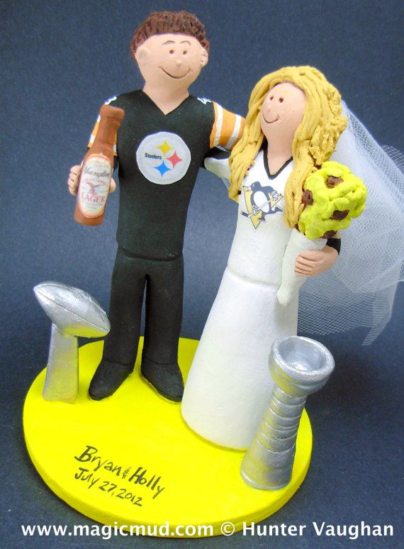 College Football Wedding Cake Topper - Football Bride Wedding Cake Topper  Personalized Custom Made Wedding Cake Topper, created just for you!     This photographed listing is but an example of what we will create for you....simply email or call toll free with your own info and pictures of yourselves, and we will sculpt for you a treasured memory from your wedding!    $235 #magicmud 1 800 231 9814 www.magicmud.com