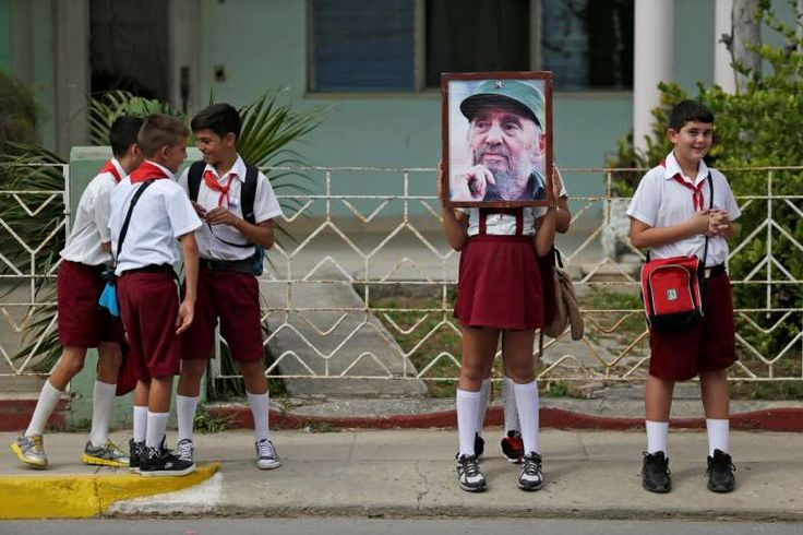 Fidel Castro's ashes travel across Cuba:    Children stand along a street while waiting for the ashes of Fidel Castro to pass in Cardenas, Cuba.