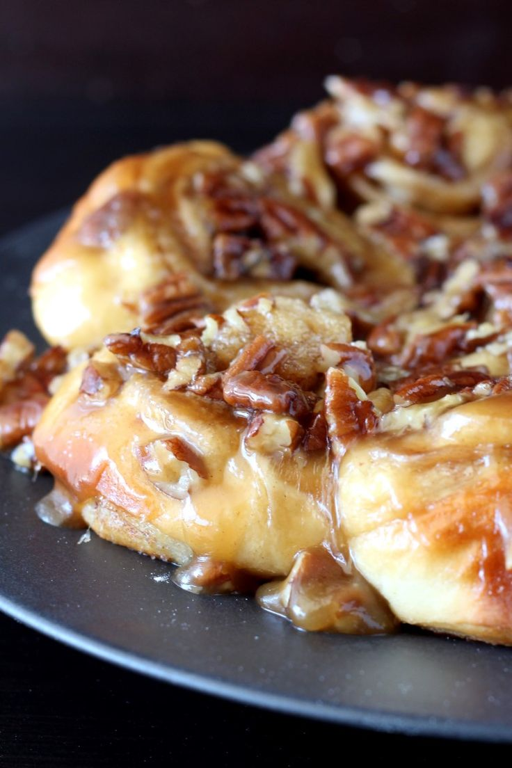 Caramel Pecan sticky buns feature soft cinnamon rolls covered in a sweet brown sugar, pecan topping.