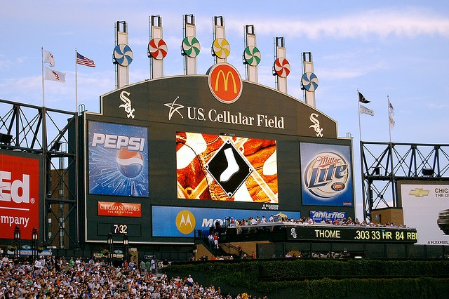 scoreboard with 7 giant pinwheels; repeating the look at old comiskey, formerly next door:   us cellular field; chicago