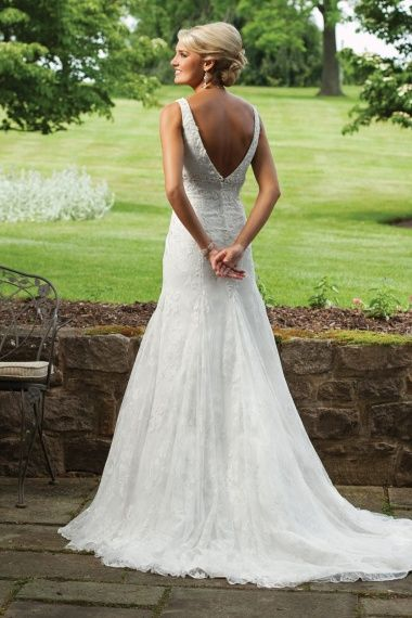 Gorgeous....a wedding gown that's NOT strapless for a welcoming change