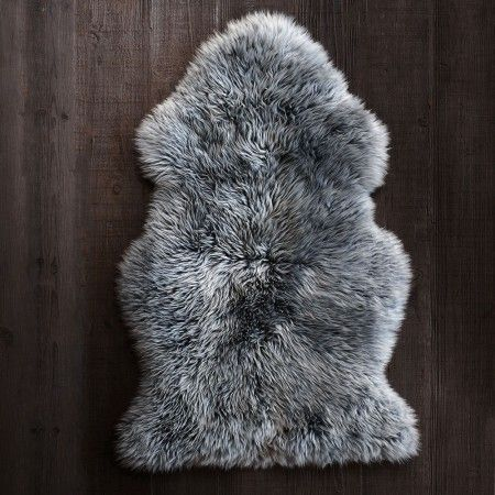 Sheepskin rugs are sumptuously soft. Drape them over sofas and easy chairs to invite guests to sit awhile. #IWANTTHATSTYLE