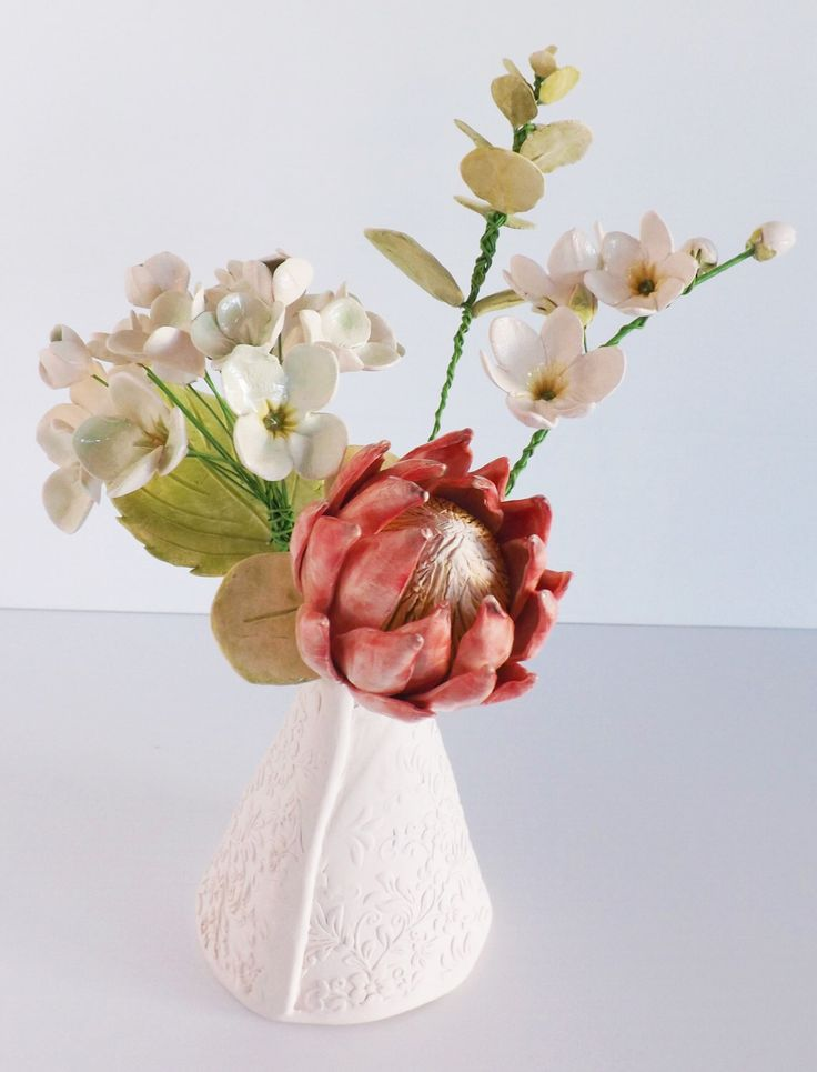 Ceramic Flower bouquet in a textured vase all hand crafted pottery by BronsCeramics on Etsy https://www.etsy.com/au/listing/385268348/ceramic-flower-bouquet-in-a-textured