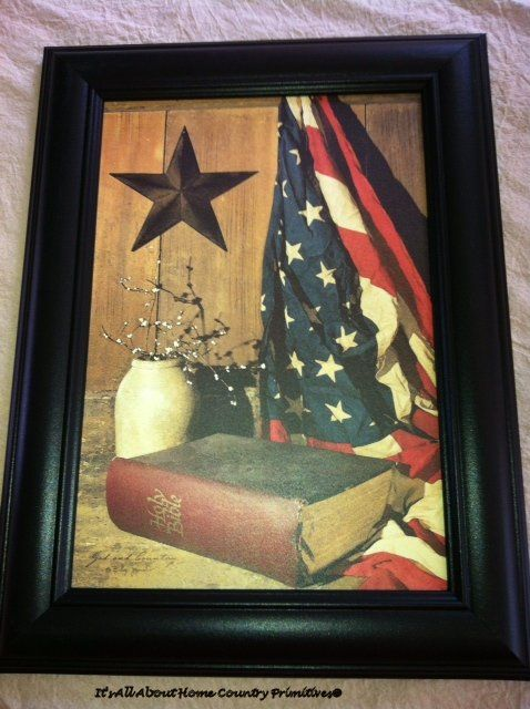 "God and Country Billy Jacobs print in a black frame, canvas, measures 11.5""W x 15.5"" L Price: $23.00."