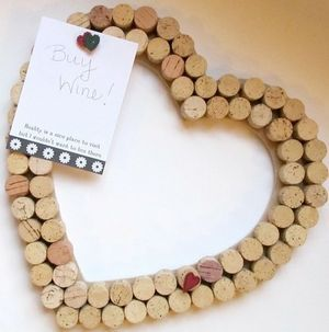 Cork Bulletin Board -- good use for wine corks! --- Supplies: -Any kind of base board (matte, foam board, etc.)  -Hot glue  -Push pins.  Instructions:    *Simply hot glue the corks onto whatever base you choose.  *Let dry before hanging on wall.  *Use push pins to hang up little notes!