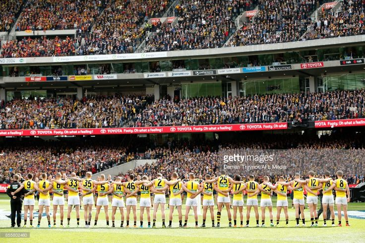 Richmond players line up for the national anthem before the 2017 AFL Grand Final match between the Adelaide Crows and the Richmond Tigers at Melbourne Cricket Ground on September 30, 2017 in Melbourne, Australia. (Photo by Darrian Traynor/AFL Media/Getty Images)