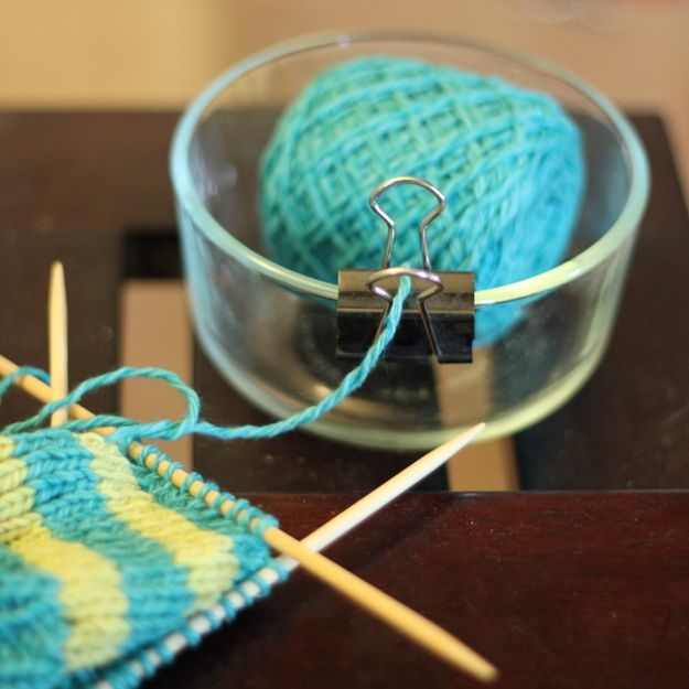 Make a yarn bowl with a binder clip so your yarn doesn't get tangled/roam across the land. Would work for crochet too or anything that involves a ball of something!