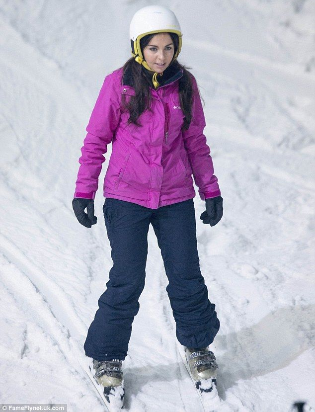Rival: The 34-year-old was not alone as she was joined on the slopes by actressLouisa Lytton