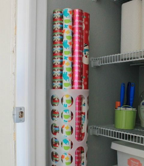 This two-buck container from IKEA is meant to store plastic grocery bags, but also succeeds in keeping gift wrap tidy and easily accessible. See more at Interior Candy »