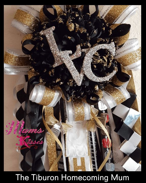 The Tiburon Homecoming Mum by Mums and Kisses. This black and gold homecoming mum is a hot seller! All Satin, no Acetate ribbons, a keepsake for years to come! www.mumsandkisses.com