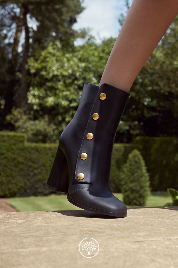 Shop the Marylebone Mid Heel Booties in Black Leather at Mulberry.com. The Marylebone Bootie is a versatile, elegant style that is suited to styling with dresses, skirts or trousers. The press studs that feature on the sides of each Bootie are a signature detail introduced by Creative Director Johnny Coca and can be found throughout the collection.