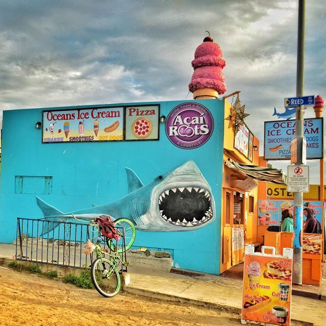 Colorful kiosk on the beach.  Eat or be eaten! :)