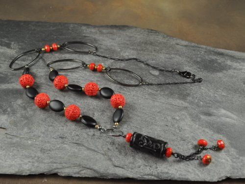 Asian Inspiration. This necklace uses matte black beads, carved Cinnabar, and fire-polished beads. The focal bead is carved Onyx pendant.