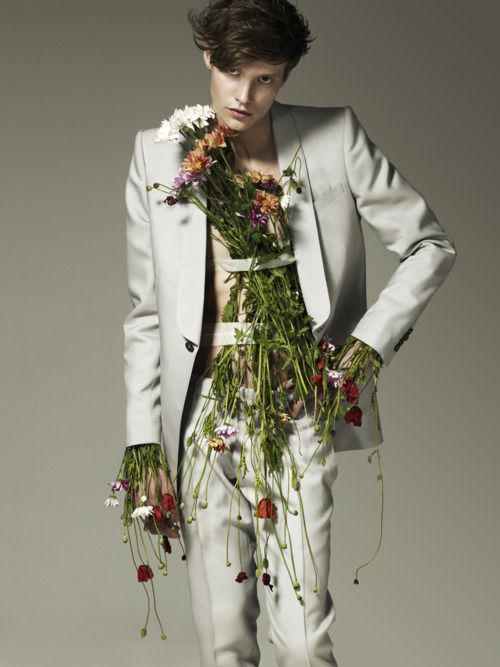 Is it weird that I like that the flowers coming out of his sleeves look like  alien tentacle hands?