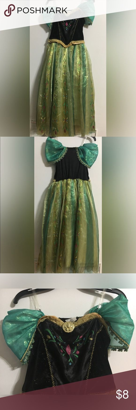 Anna Disney Store Costume, Girls size 9/10 Princess Anna from Frozen's Gown. Size 9/10 from The Disney Store. Good used condition. Beads on the sleeves have lost their color in some spots as shown in pictures. Dress has clear shoulder straps. Very good quality with lots of detail. Disney Costumes