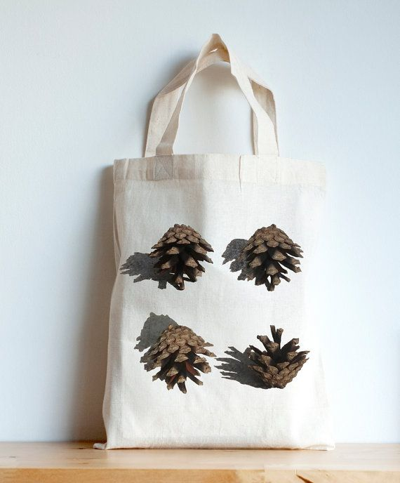 This autumn print, pine cone mini tote bag is perfect for storing a lunch on the go or for storing those amazing finds on forest walks!  100% unbleached cotton. Size: 32cm x 26cm / 12.5in x 10in  Made from a sustainable cotton crop and sewn in a Fairtrade Factory in India, the photo is taken by Helena Lee and printed using water-based inks in Bidbis Eco-print factory in Yorkshire, England.   Thanks for looking and enjoying the small but nonetheless beautiful things in life!  https:/...