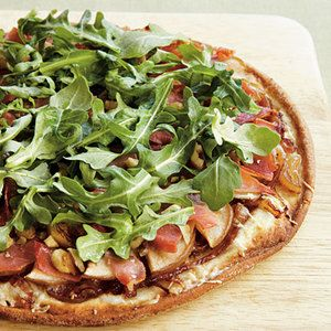 Peppery arugula, sweet caramelized onion and salty prosciutto elevate #glutenfree pizza to gourmet status. Recipe from My Recipes, found at www.edamam.com