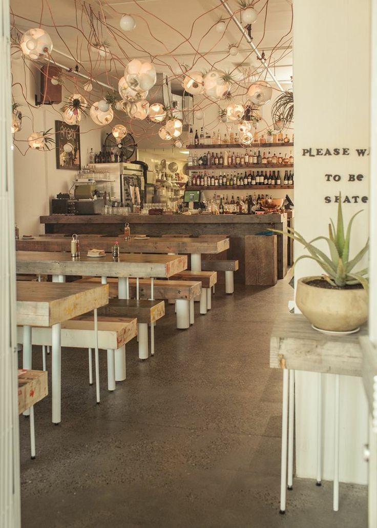 #casual restaurant design masculine rustic tacofino vancouver community table concrete