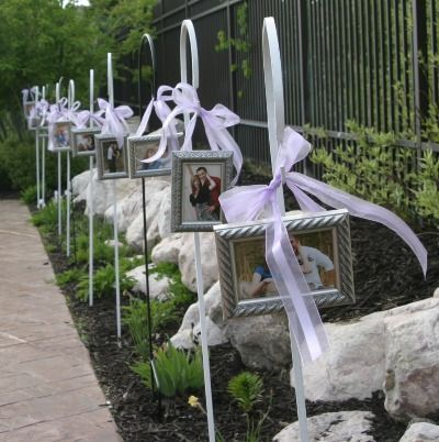 I love this idea! For a church wedding the frames and bows could be attached to the end of the pews! :)