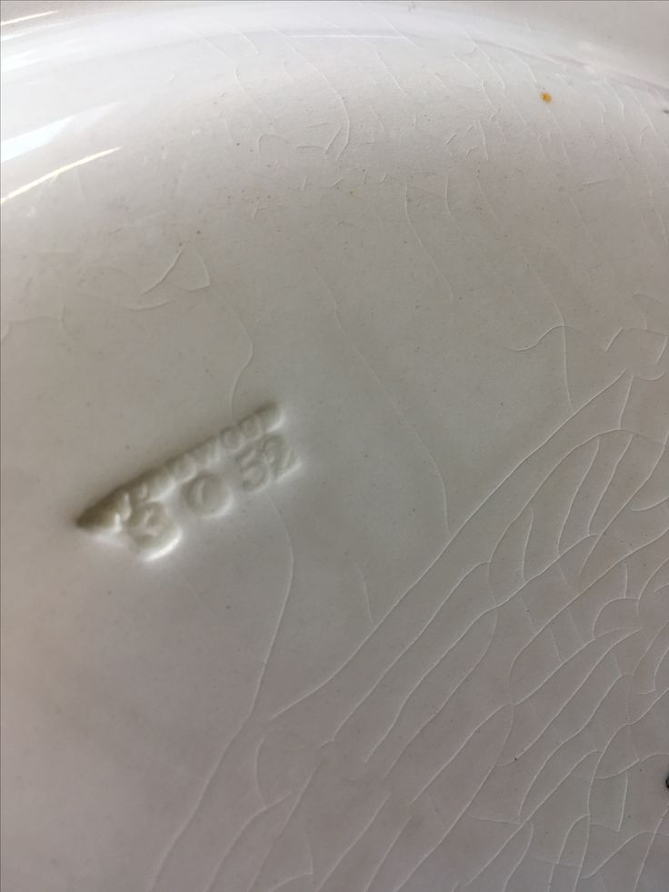 Stamp on bottom of plate.