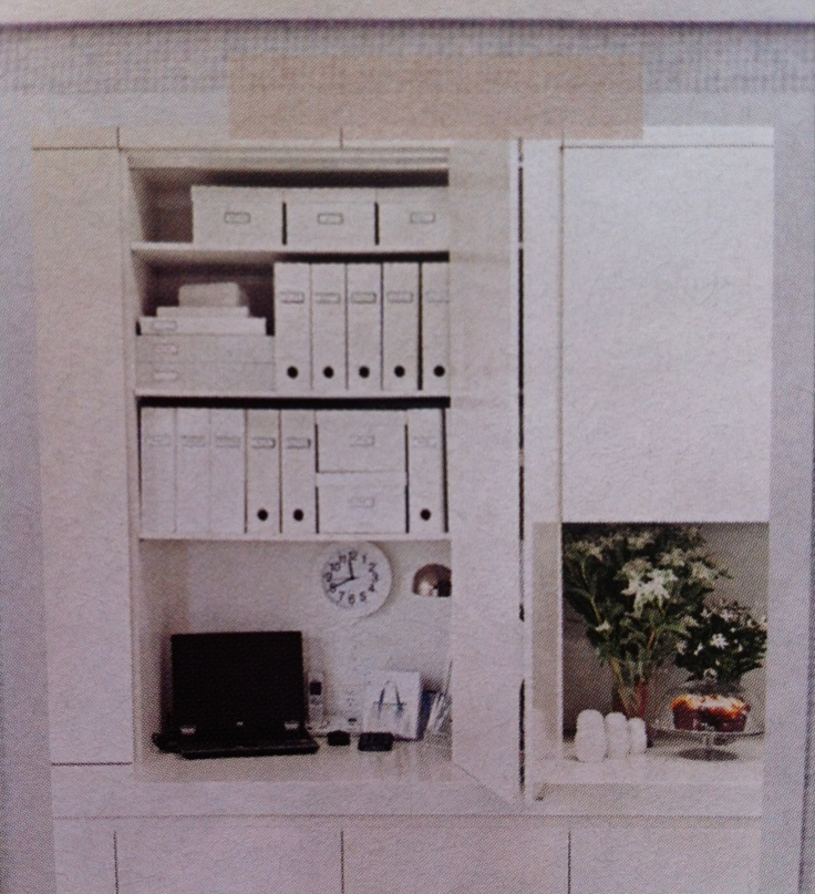 Kitchen cabinetry conceals a cute study nook.