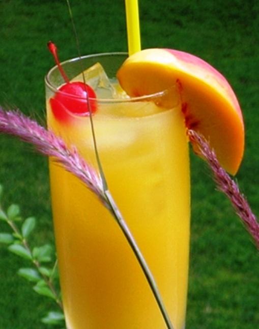 Peach Pirate: 2 ounces Captain Morgan's Spiced Rum, 2 ounces Peach Schnapps, 4 ounces Orange Juice, Slice of fresh Peach and Cherry for garnish