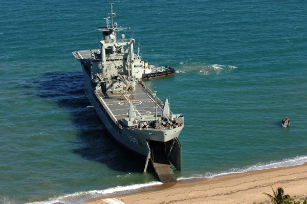 HMAS Tobruk (II) gives the Australian Defence Force an amphibious heavy lift capability. The ship is a multi -purpose troop and roll-on/roll-off, heavy vehicle carrier built by Carrington Slipways Pty Ltd at Tomago, near Newcastle , NSW. The design includes facilities for bow and stern loading, beaching, a drive-through capacity and inter-deck transfers via ramps.Tobruk (II) can transport 18 tanks, 40 Armoured Personnel Carriers or 40 Australian Light Armoured Vehicles.