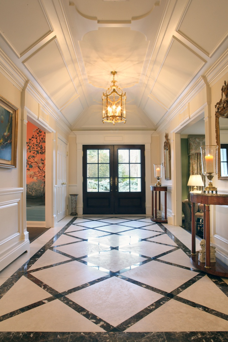 Elegant paneled entrance with custom designed marble floor for Entrance flooring ideas