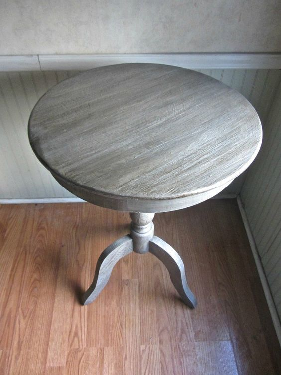 """Pedestal+Table+With+Weathered+Finish I painted the table in a medium grey chalk paint called """"Waverly"""" which is available at Walmart and a few other stores. It's a little more cost effective. Then I added some white of the same paint into the container with the grey and mixed only slightly. Then using a dry brushing technique I applied the lighter paint in one direction. Next I applied Valspar antiquing glaze to the top."""