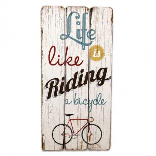 """Cartel de madera vintage con la frase """"Life is like a riding a bicycle. Podrás encontrarlo en nuestra tienda online. www.honeypoppies.com"""