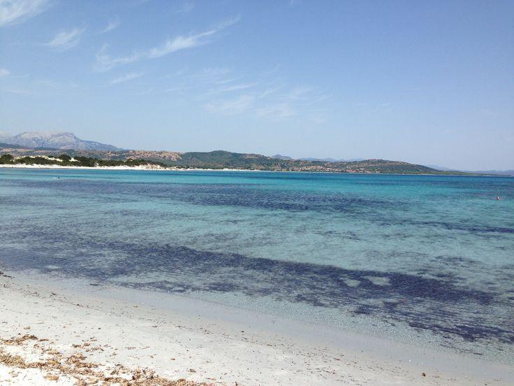 Capo Comino, Sardinia low and transparent water.