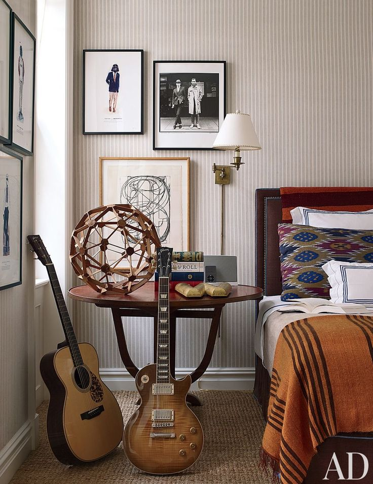 In a Manhattan townhouse designed by Jeffrey Bilhuber, Collings and Gibson Les Paul guitars stand alongside a 19th-century French tilt-top table in a boy's bedroom.