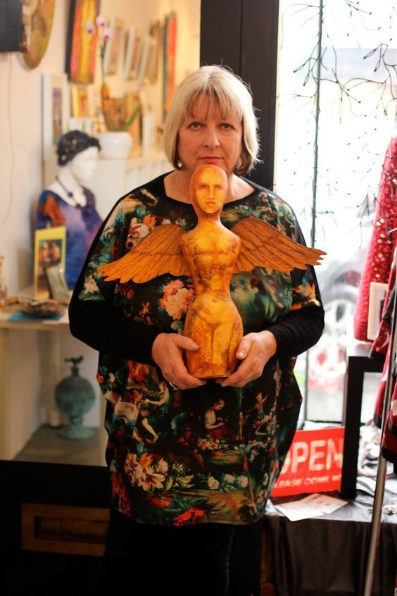 Sylvia Convey with one of her cloth dolls at Gallery Stimuleye.