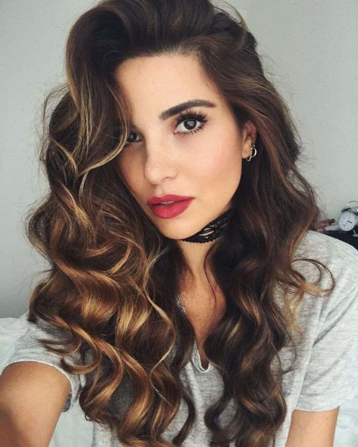 Get a bombshell beauty look with glamorous mermaid waves and a red lip