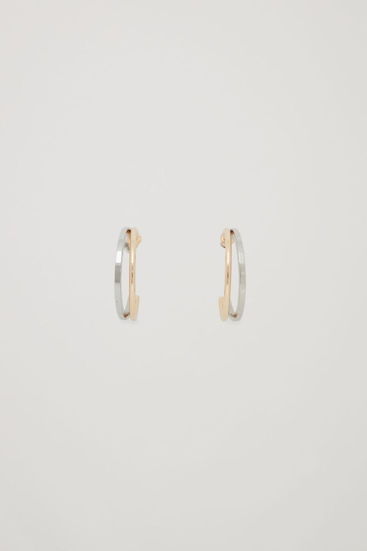 These hoop earrings are made from two-tone brass with a polished finish. A split design, they have neat soldered ends, a round-cross cut wire to one side and a square cross-cut wire to the other.