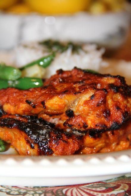 Tandoori Chicken with Cilantro Yogurt Sauce.  Still looking for the perfect tandoori chicken recipe