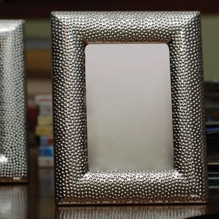 A sterling silver frame with dotted pattern for a silver anniversary or wedding gift.