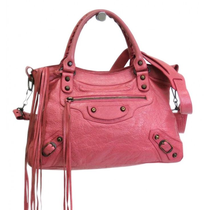This authentic BALENCIAGA Town Shoulder Bag is finely crafted from pink distressed lambskin. The interior opens to a black textile. Featuring incredible hardware stud detailing and a cosmetic size mirror the Town Bag has a chic shape that has made it famous the world over. The detachable shoulder strap gives you the option to wear it as a cross body on your hip. Loved by celebrities everywhere the Town is a must have. For more items like this visit https://www.swayy.com.au/